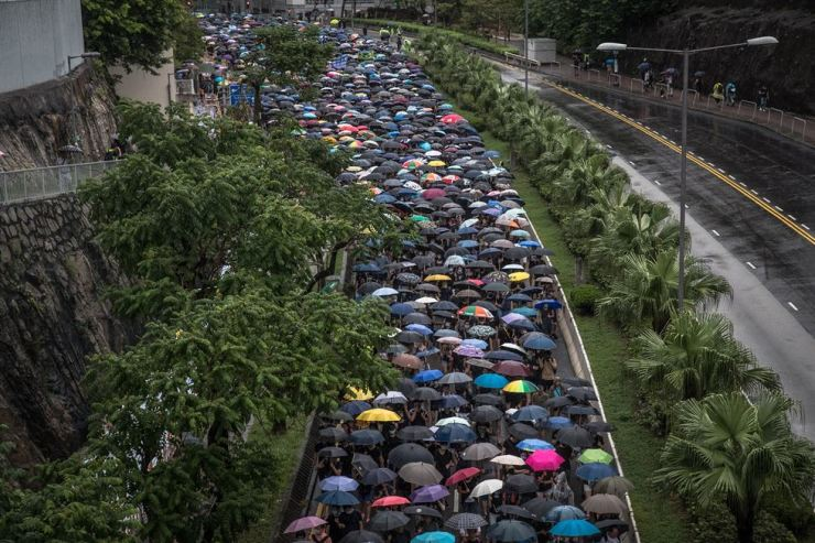 Protesters carrying umbrellas take part in a march themed 'Recover Hung Hom' in Hong Kong, China, 17 August 2019. Hung Hom and To Kwa Wan are popular areas for low-cost travel tours from mainland China. The city braced itself for another weekend of protests demanding the full withdrawal of a now-suspended extradition bill as well as the appointment of a judge-led independent inquiry into police use of force on protesters since June. EPA/ROMAN PILIPEY