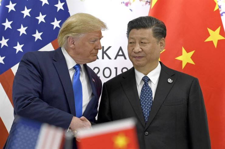 In this June 29, 2019, file photo, U.S. President Donald Trump, left, shakes hands with Chinese President Xi Jinping during a meeting on the sidelines of the G-20 summit in Osaka, western Japan. AP-Yonhap