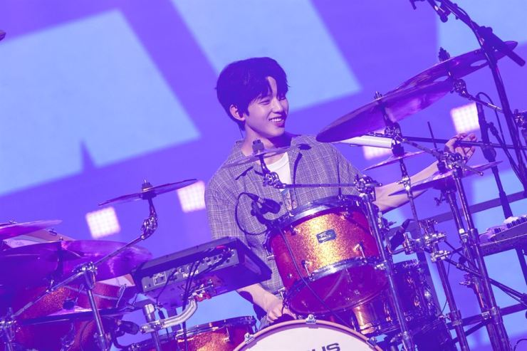 DAY6 drummer Do-woon plays at a World Tour concert in Seoul held at Jamsil Indoor Stadium, Sunday./ Courtesy of JYP Entertainment