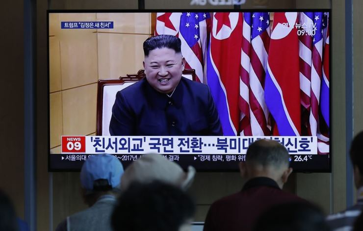 People watch a TV news program reporting about North Korea's projectiles with a file image of North Korean leader Kim Jong-un at the Seoul Railway Station in Seoul, South Korea, Saturday, Aug. 10, 2019. AP