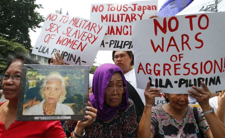 Protesters display placards during a rally near the Presidential Palace to mark the 74th anniversary of the end of World War II in Manila, Philippines, Aug. 14. In their statement, the protesters lamented the fact that after 74 years since the end of World War II, Japan still 'refuses to atone for its wartime atrocities and has now embarked on a campaign to silence efforts to commemorate by causing the removal of all memorials related to the issue.' AP
