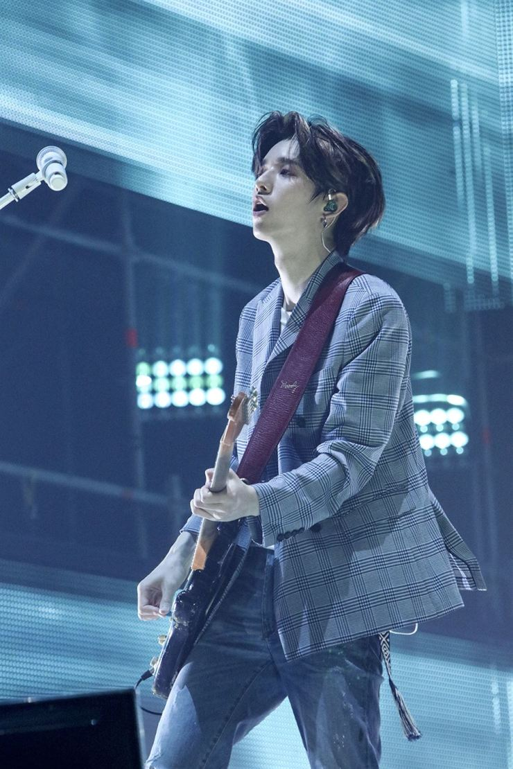 DAY6 guitarist Jae plays at the World Tour concert in Seoul held at Jamsil Indoor Stadium, Sunday./ JYP Entertainment