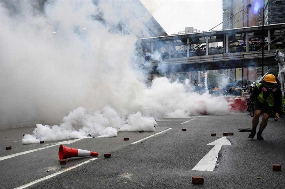 Protesters wearing gas masks react after the police fired tear gas during an anti-government rally in Tsuen Wan, in Hong Kong, Aug. 25. The protests were triggered by an extradition bill to China in June, now suspended, and evolved into a wider anti-government movement with no end in sight. EPA