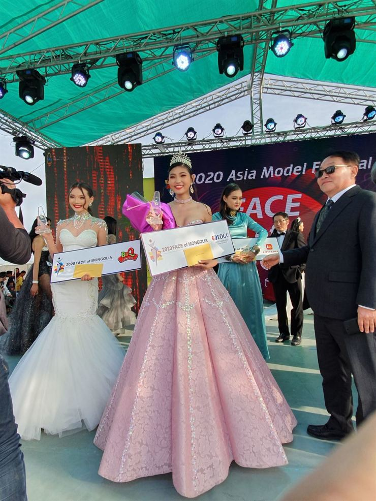A. Indra, center, won the EDGC grand prize in the
