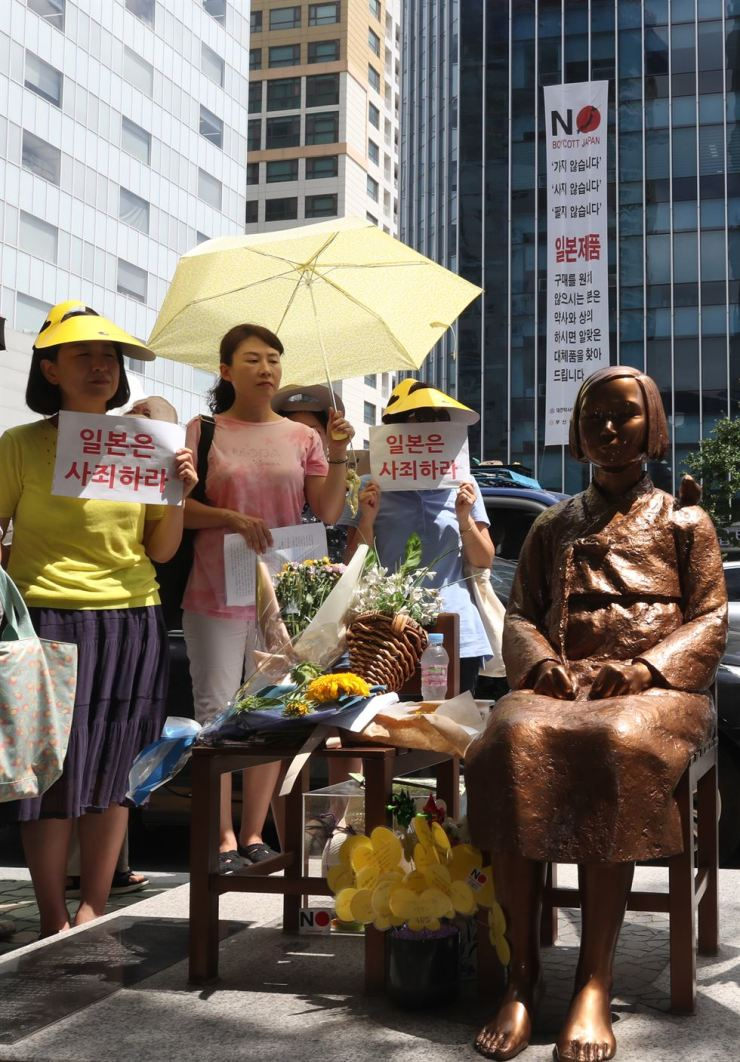 Busan citizens stage another Wednesday rally near the statue symbolizing