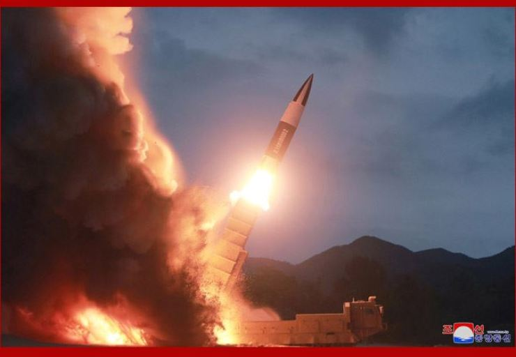 This photo released by North Korea's state-run Korean Central News Agency (KCNA), Sunday, shows North Korea test firing a new weapon a day before. Weapons experts said the North's new weapon seemed to bear traits of the U.S. Army's tactical missiles system. KCNA-Yonhap