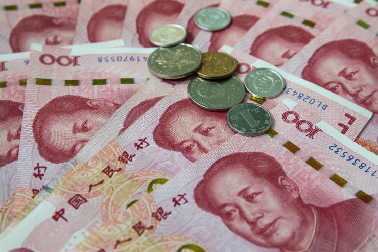 Chinese 100 yuan or renminbi (RMB) notes and coins in Beijing, China, Aug. 5. According to reports, the U.S. Treasury department formally label China as a currency manipulator. /EPA