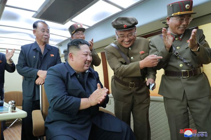 North Korean leader Kim Jong-un guides the test firing of a new weapon, in this undated photo released on Aug. 16, 2019 by North Korea's Korean Central News Agency. Korean Central News Agency-Yonhap.