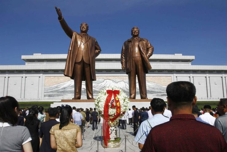In this July 8 file photo, people visit Mansu Hill to pay tribute to the late leaders Kim Il-sung and Kim Jong-il on the occasion of the 25th anniversary of Kim Il-sung's death in Pyongyang, North Korea. AP