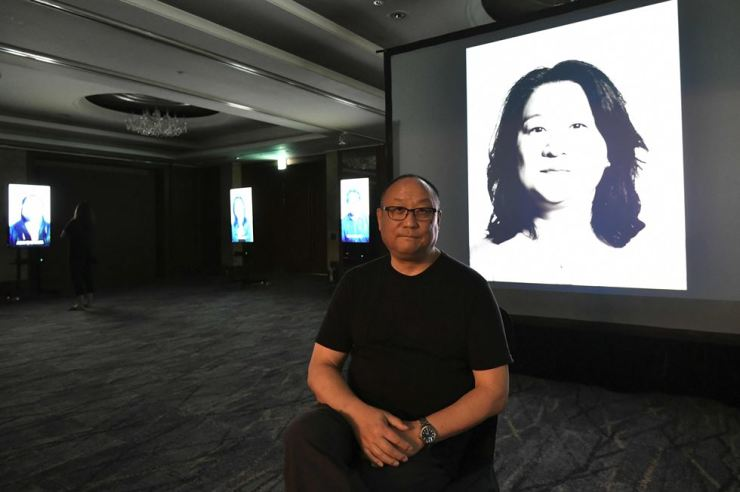 This picture taken on July 31, 2019 shows Korean-American adoptee Glenn Morey during an interview with AFP at an exhibition hall for his latest film project on adoption in South Korea, Side x Side, in Seoul. (Photo by Jung Yeon-je / AFP)