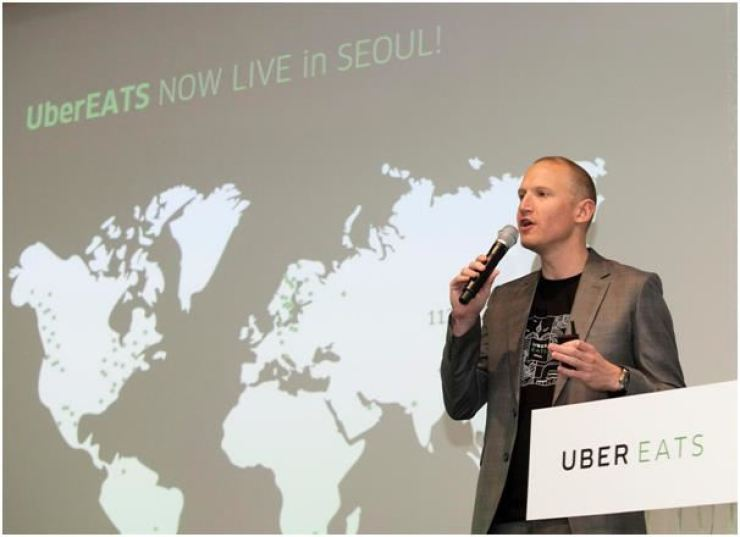 In this 2017 file photo, Uber Eats' then Asia-Pacific head Allen Penn speaks during a press conference to launch its business in Korea. Korea Times file