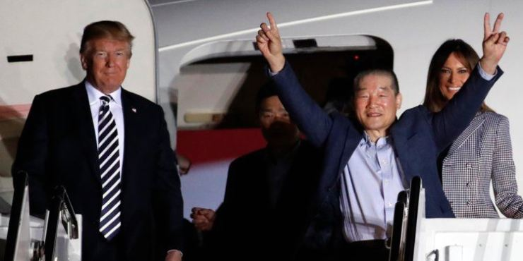Kim Dong-chul, who had been a captive of North Korea, is welcomed back to America by President Donald and his wife Melania Trump at Joint Base Andrews on May 10 2018. AP