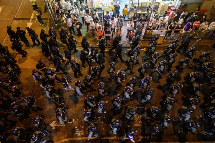 Riot police patrol along a street during a protest in Mong Kok district in Hong Kong on Sept. 7, 2019. Riot police fanned out across Hong Kong in a bid to thwart plans by pro-democracy protesters to target the airport in the movement's first mass mobilisation since the city's leader made a surprise concession earlier this week. AFP