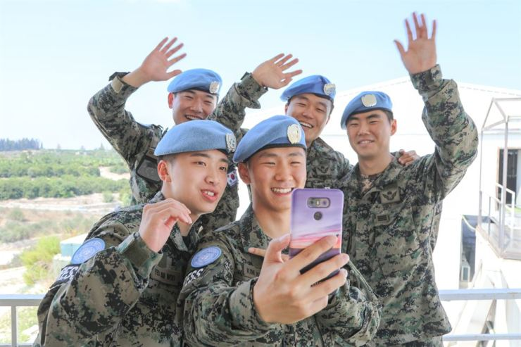 Soldiers of the Republic of Korea's Dongmyeong unit in Lebanon make video calls to their families in South Korea. Courtesy of Dongmyeong unit