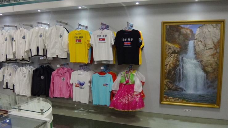 T-shirts with the North Korean flag are displayed at a shop in Pyongyang, North Korea, November 2018. Anyone who wears such T-shirts in South Korea could be prosecuted for violating the National Security Act. Korea Times photo by Jung Min-ho