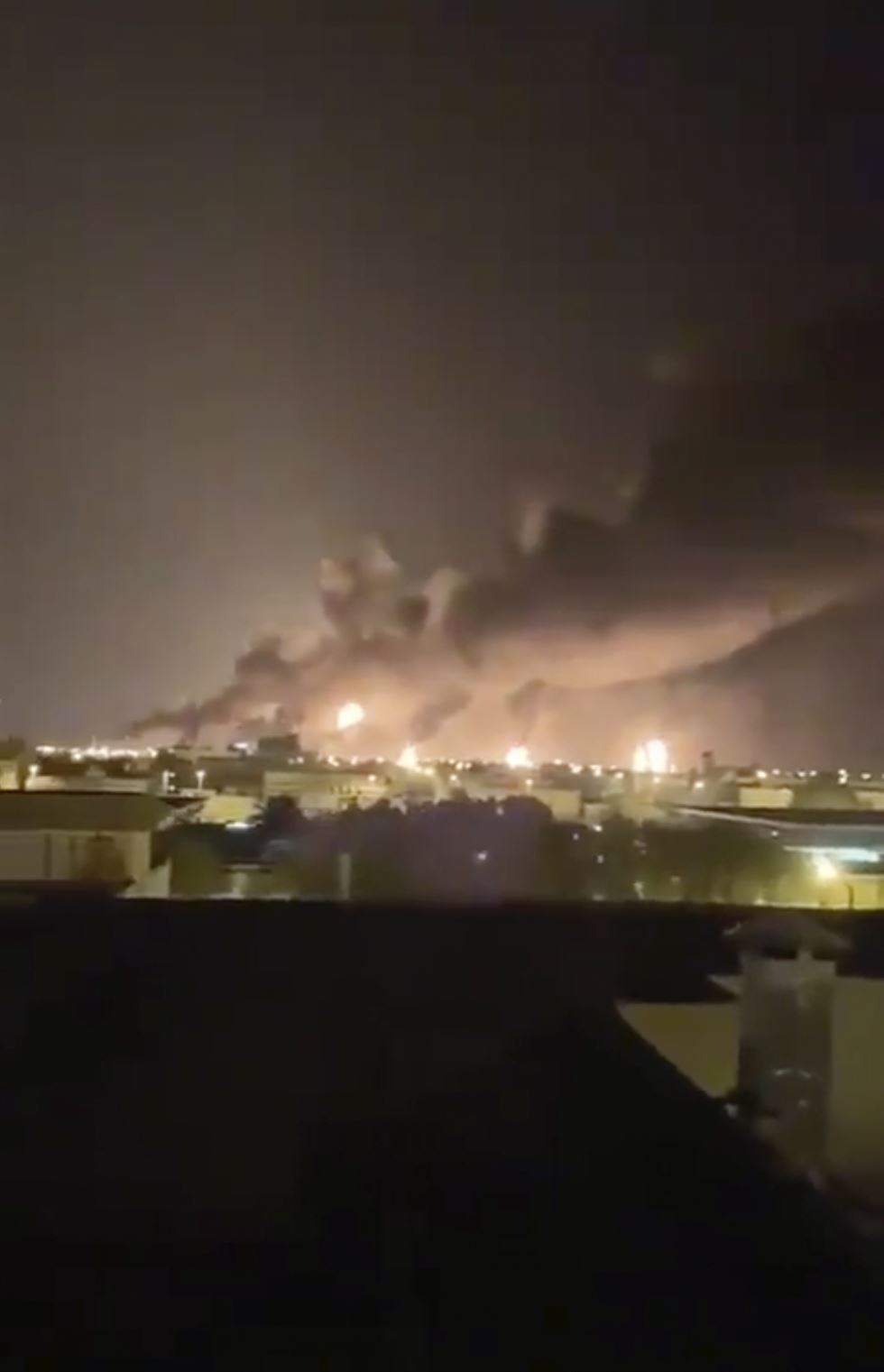 Fires burn in the distance after a drone strike by Yemen's Iran-aligned Houthi group on Saudi company Aramco's oil processing facilities, in Buqayq, Saudi Arabia September 14, 2019 in this still image taken from a social media video obtained by REUTERS