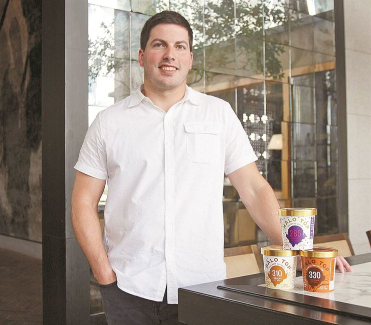 Halo Top Creamery president and COO Doug Bouton poses for a photo with tubs of ice cream after an interview with The Korea Times at the Grand Hyatt Hotel Seoul, Aug. 21. Courtesy of Halo Top Creamery