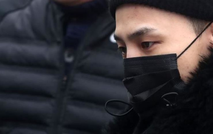 G-Dragon enters The Army's 3rd Infantry Division in Cheorwon County, Gangwon Province, in February 2018. Yonhap
