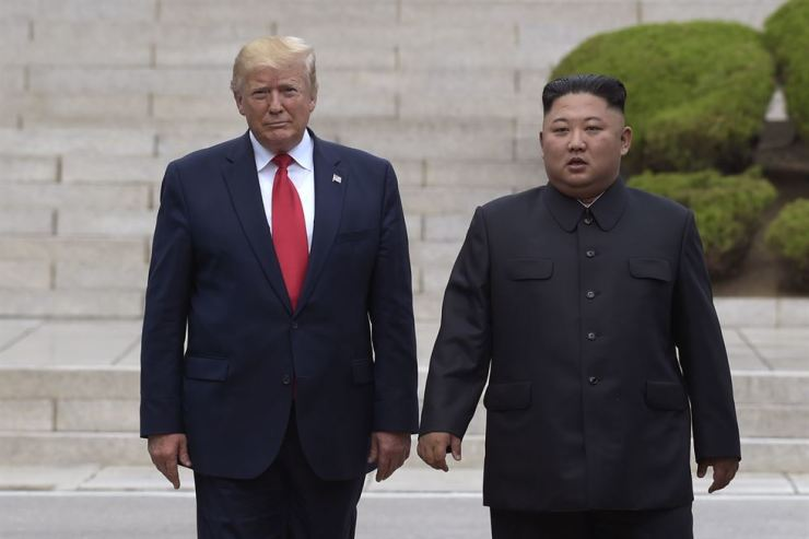 In this June 30, 2019, file photo, U.S. President Donald Trump, left, meets with North Korean leader Kim Jong-un at the North Korean side of the border at the village of Panmunjom in Demilitarized Zone. North Korea's chief negotiator says discussions with the U.S. on Pyongyang's nuclear program have broken down, but Washington says the two sides had 'good discussions' that it intends to build on in two weeks. AP
