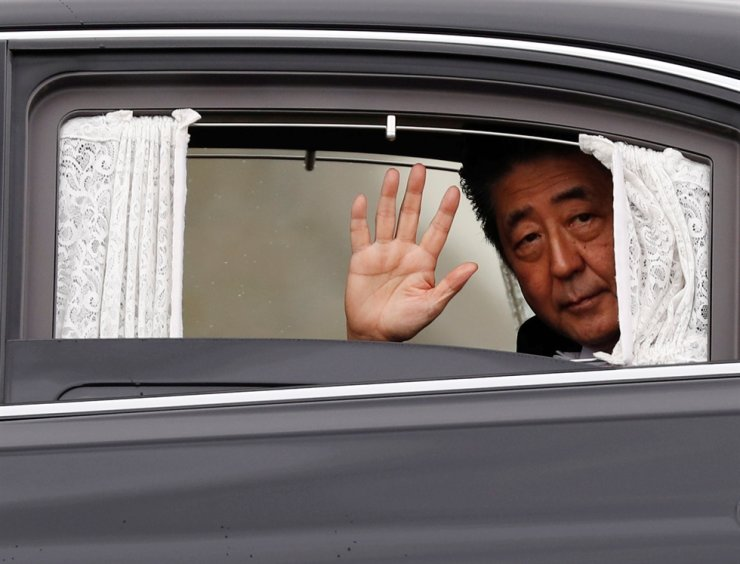 Japan's Prime Minister Shinzo Abe departs the Imperial Palace after the enthronement ceremony of Emperor Naruhito in Tokyo, Japan October 22, 2019. Reuters-Yonhap