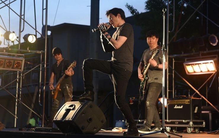 Sebastian W. Suh performs with metal band Crux at an outdoor festival in 2018. Crux performs at Mullae Metal City this Saturday. / Korea Times photo by Jon Dunbar