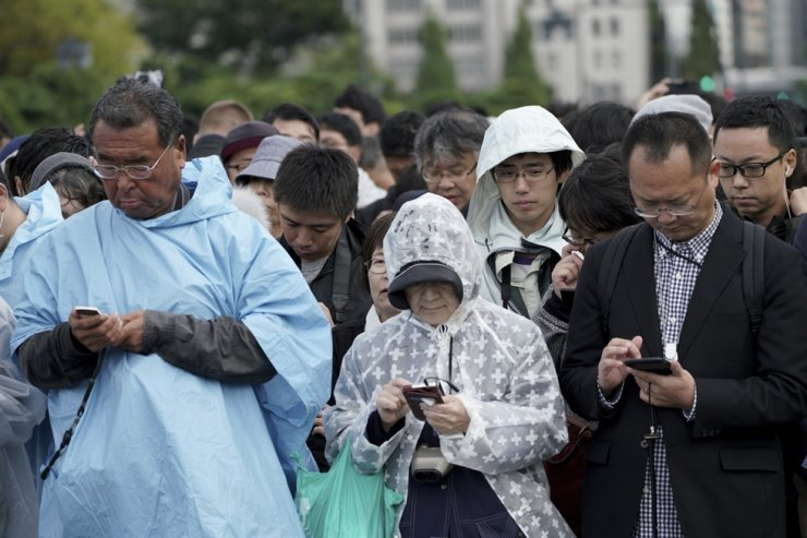 People line up outside of the Tokyo Imperial Palace during the enthronement ceremony for the 59-year-old Emperor Naruhito, Tuesday, Oct. 22, 2019, in Tokyo, Japan. AP-Yonhap