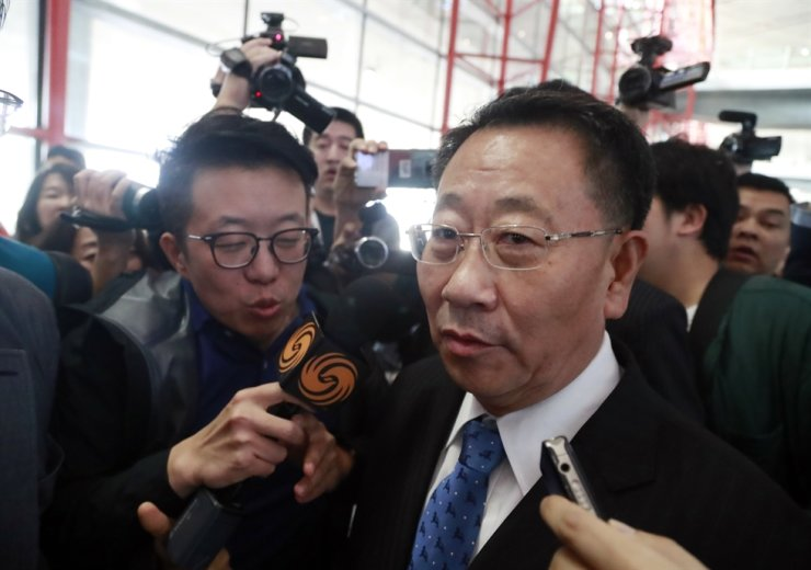 Kim Myong-gil, North Korea's chief nuclear negotiator, answers questions from reporters at the Beijing Capital International Airport en route to Pyongyang after ending a working-level dialogue with the United States, Monday. Yonhap