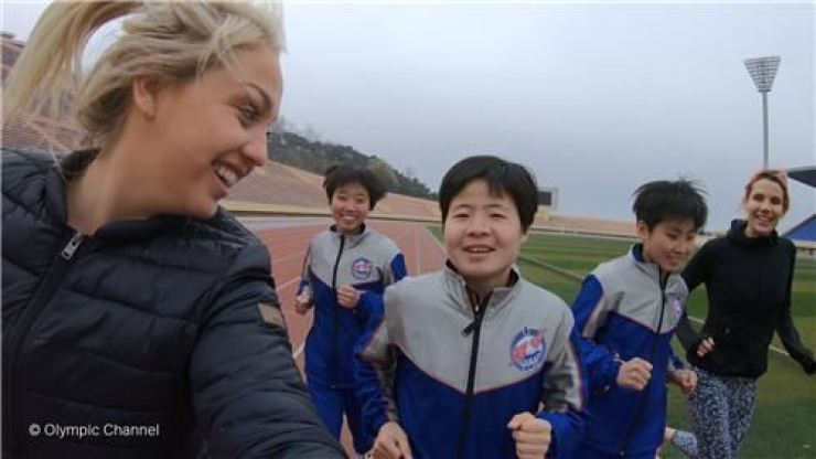 Aimee Fuller of Britain, left, and Mirjam Jaeger of Switzerland, right, train with North Korean athletes in preparation for the Mangyongdae Prize International Marathon in Pyongyang on April 7, 2019. Olympic Channel-Yonhap