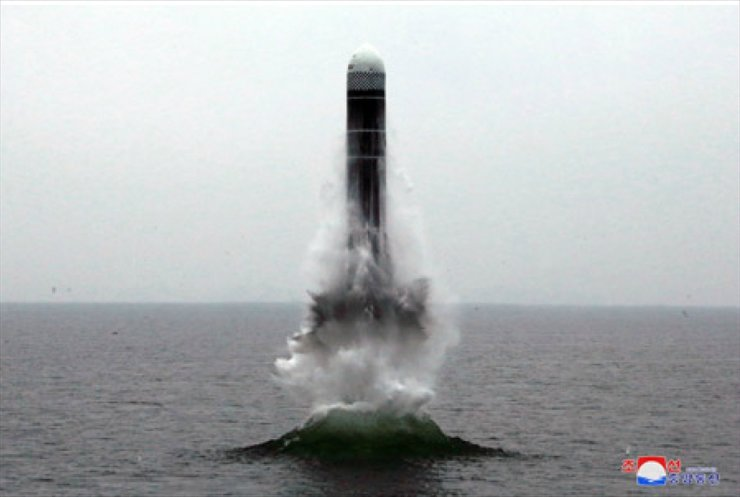 Seen above is North Korea's new submarine-launched ballistic missile launched in waters off the country's eastern city of Wonsan, on Oct. 3. Yonhap