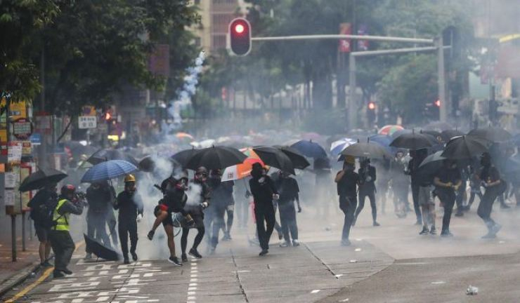 Tear gas has blighted Hong Kong's streets since June, but confrontations have also broken out in the online world. Photo from South China Morning Post