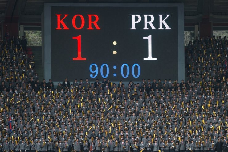 In a file photo taken on April 7, 2017 a display board shows the final score of the AFC Women's 2018 Asian Cup Group B qualifying football match between North Korea and South Korea at the Kim Il-Sung stadium in Pyongyang. - North and South Korea face each other in a World Cup qualifier on October 15, 2019 for their first ever competitive men's match in Pyongyang, while talks on the North's nuclear arsenal remain deadlocked. (Photo by KIM WON-JIN / AFP)