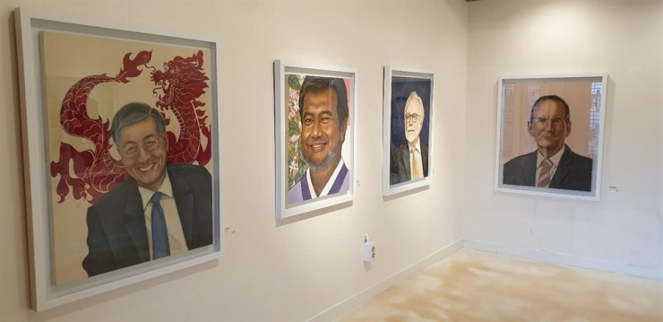 From left are portraits of ambassadors to Korea: Qiu Guohong of China, Umar Hadi of Indonesia, Michael Reiterer of the European Union and Michael Danagher of Canada. / Korea Times photo by Yi Whan-woo