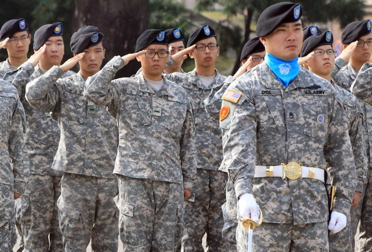 KATUSAs salute during a 60th anniversary ceremony of the establishment of KATUSA at USAG Yongsan in Seoul, in this October 2010 photo. The Korean Army plans to reduce KATUSA recruitment by over 25 percent by 2022. Korea Times file