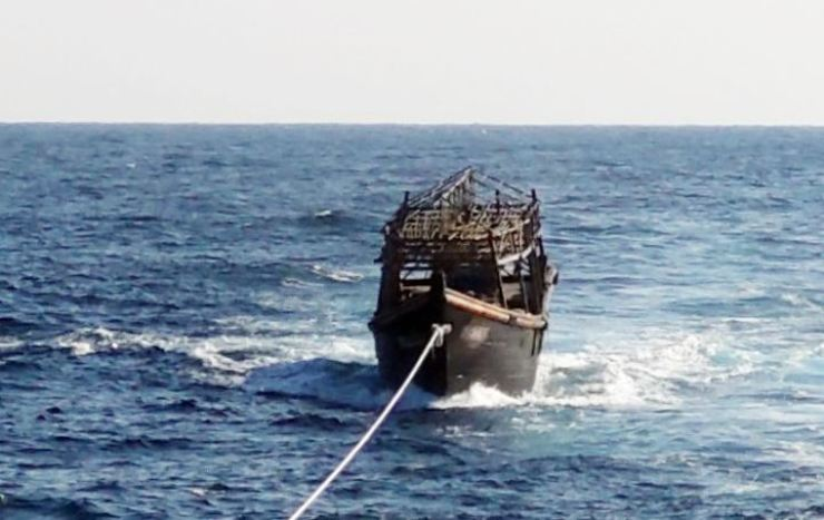 A boat on which two North Korean fishermen allegedly killed 16 other crew members is towed by a South Korean Navy vessel in the East Sea, Nov. 8. / Yonhap