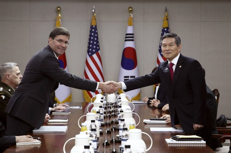 U.S. Defense Secretary Mark Esper, left, shakes hands with South Korean Defense Minister Jeong Kyeong-doo, right, during their meeting Friday, Nov. 15, 2019 in Seoul, South Korea. (Chung Sung-Jun/Getty Images via AP)