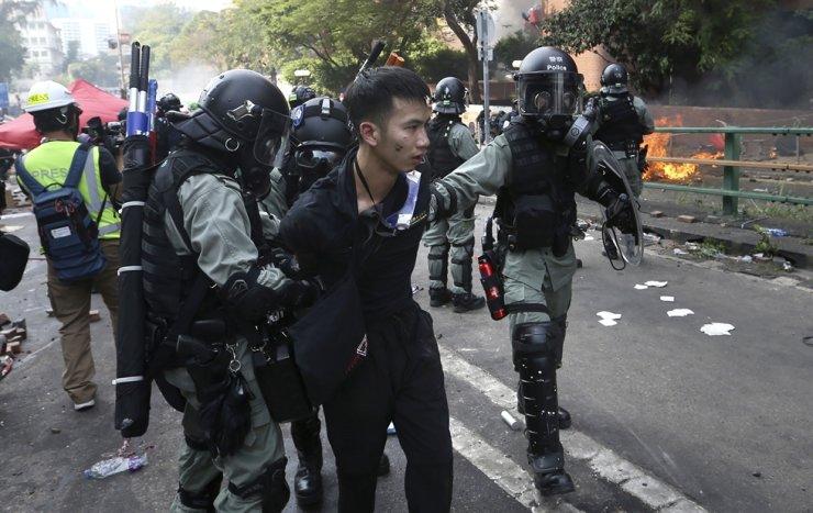 In this Monday, Nov. 18, 2019, photo, riot police detain a protester at Hong Kong Polytechnic University in Hong Kong. AP-Yonhap