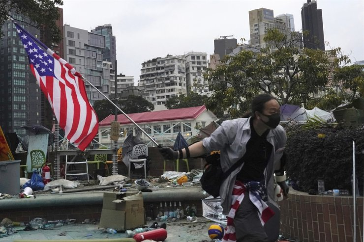 A protester holds an American flag at Hong Kong Polytechnic University in Hong Kong, early Wednesday, Nov. 20, 2019. AP-Yonhap