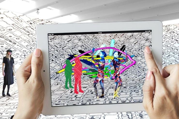Visitors can experience MR or XR-based art, such as this holographic video of dancers, through iPads, which are available at the exhibition site. / Courtesy of Production Company ONN