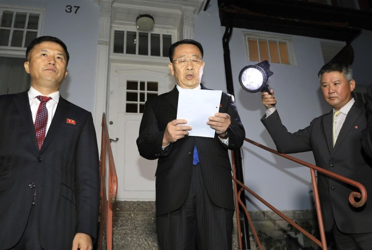 North Korean foreign affairs ministry's Kim Myong-gil, center, speaks on behalf of the state in front of the North Korean embassy in Stockholm, Sweden, Oct. 5, 2019, after he met Stephen Biegun, the United States Special Representative for North Korea, to discuss about North Korea's denuclearization process. Yonhap