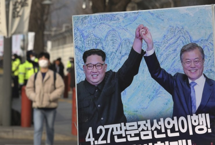 A poster showing a photo of North Korean leader Kim Jong-un and President Moon Jae-in is displayed as a gesture to wish for peace on the Korean Peninsula, in Seoul, in this Jan. 15, 2019, file photo,. AP-Yonhap