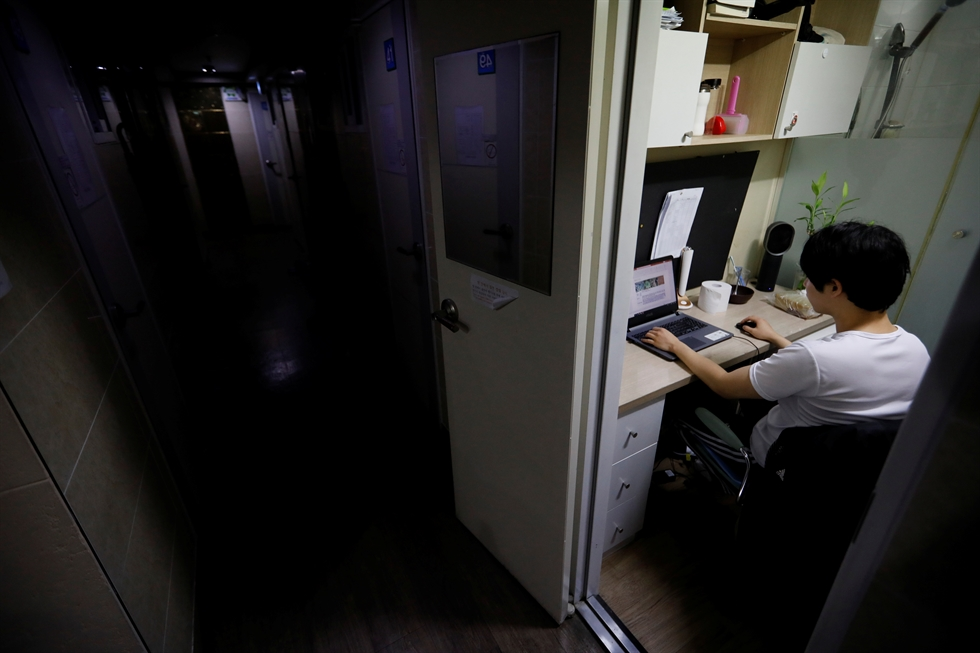 Kim Jae-hoon drinks water as he sits in his cubicle, called a goshi-won, where he lives in Suwon, South Korea, November 7, 2019. REUTERS/Kim Hong-Ji
