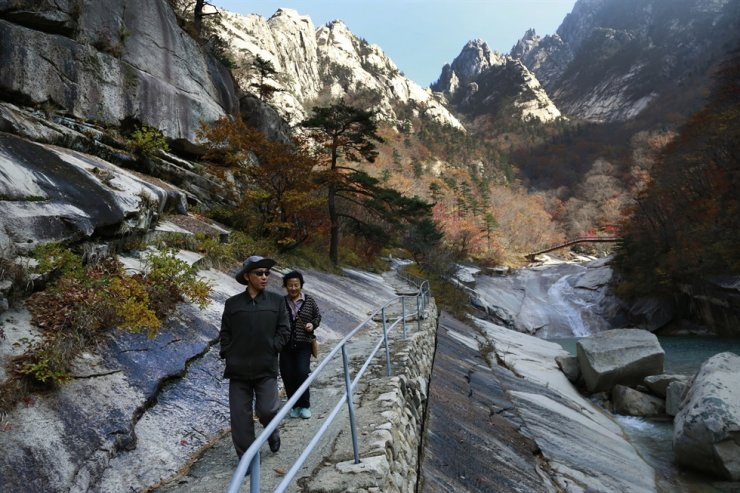 In this file photo, local tourists walk a trail at Mount Geumgang in North Korea. South Korea has offered to send a delegation to check on facilities at the long-stalled joint tourist resort in the North. AP-Yonhap