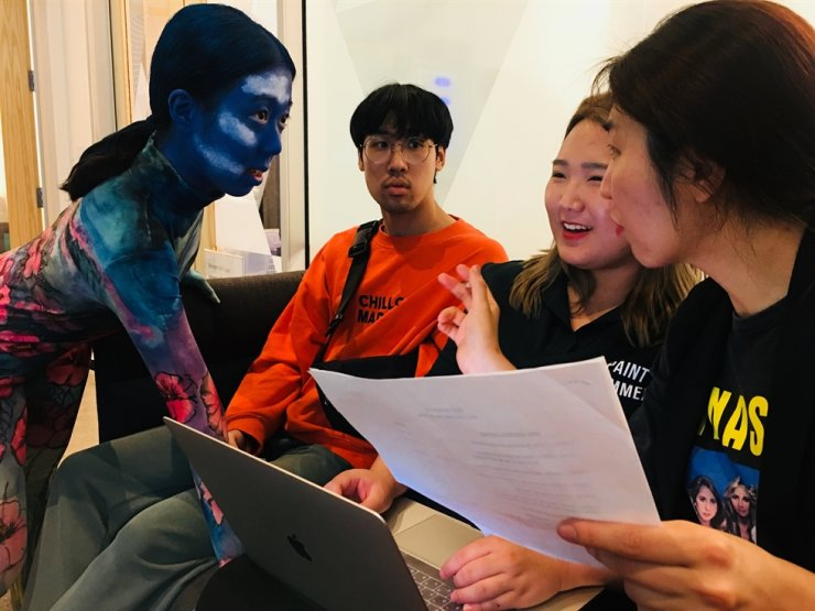 Choreographer and dancer Heo Ji-eun, left, talks with artistic director Kim In-hyun, right, during a recording session at a set in Microsoft's Mixed Reality Capture Studios in San Francisco in July 2018. / Courtesy of Production Company ONN