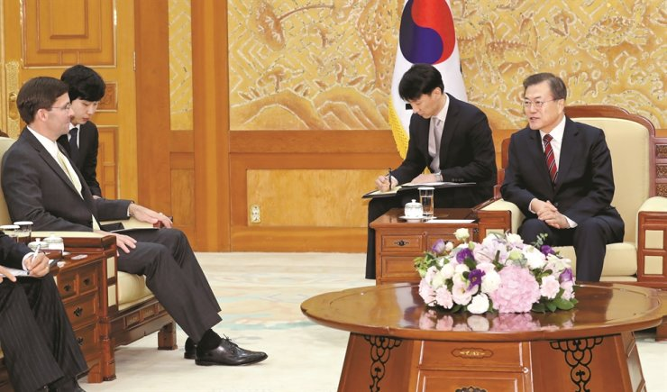 President Moon Jae-in meets with U.S. Secretary of Defense Mark Esper, who visited Seoul for annual talks between the defense chiefs of the two countries, at Cheong Wa Dae, Friday, after the 51st Security Consultative Meeting earlier the day. Yonhap