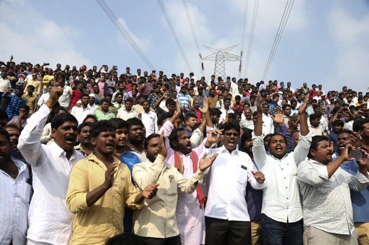 People shout slogans in favor of police and cheer them while gathering near the place where rape accused were killed in Shadnagar, some 50 kilometers or 31 miles from Hyderabad, India, Friday, Dec. 6, 2019. AP