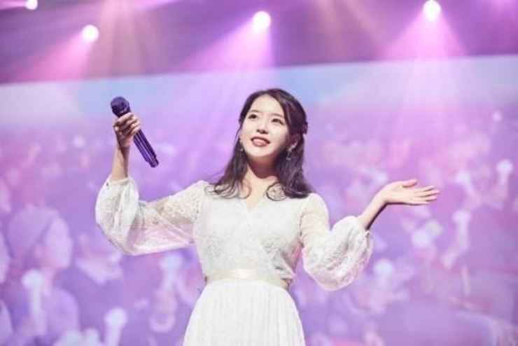 K-pop star IU is the youngest person listed on Forbes 'Asia's Heroes of Philanthropy.' Korea Times file.