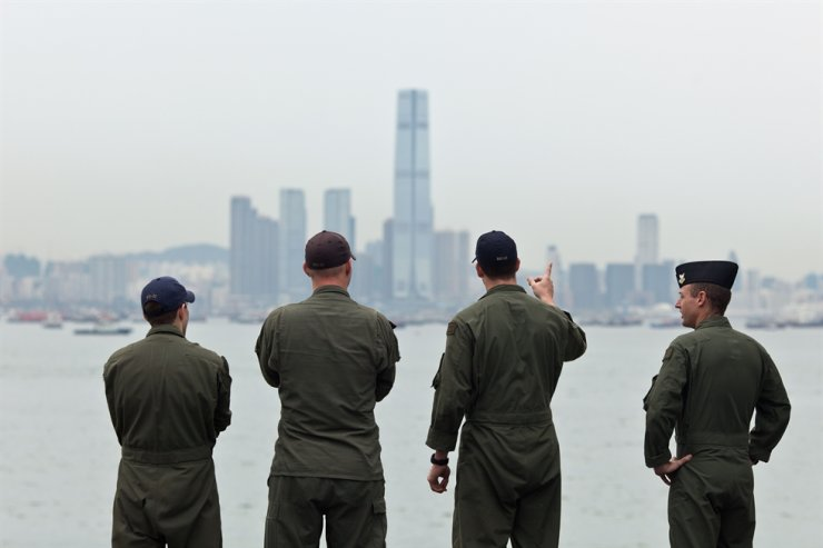 This file photo taken on August 20, 2014 shows US Navy personnel on board the USS Makin Island looking towards the ICC building (C) during a port-of-call visit to Hong Kong. AFP