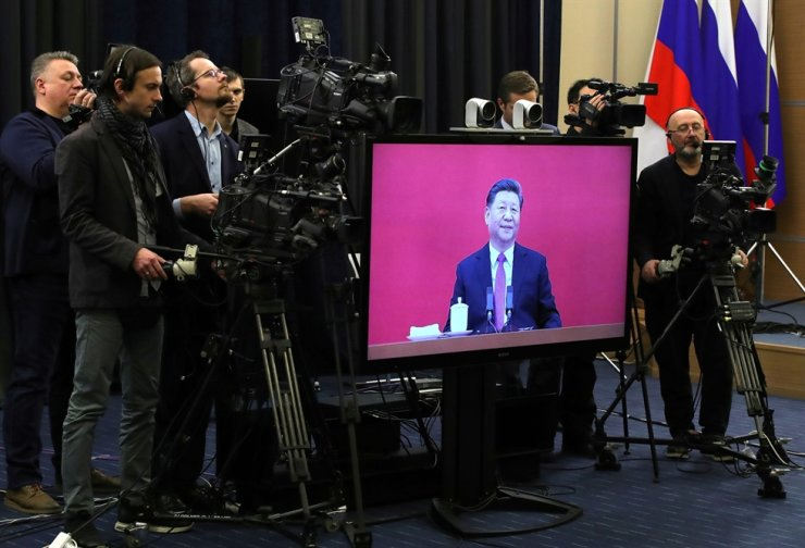 China's leader Xi Jinping holds a teleconference with Russian leader Vladimir Putin. Reuters-Yonhap