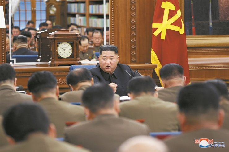 North Korean leader Kim Jong-un presides over an enlarged meeting of the ruling Workers' Party's Central Military Commission in this photo from the Korean Central News Agency (KNCA), Sunday. The KNCA did not say when the meeting was held. Yonhap