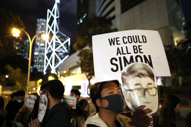 A protester holds a sign reading 'We could all be Simon' in reference to Simon Cheng, a Hong Kong British Consulate employee who was detained in China, during a rally outside of the British Consulate in Hong Kong, Friday, Nov. 29, 2019. AP